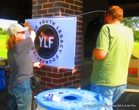 TeamWork: Putting up YFL Sign/Logo!