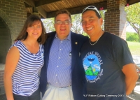 YLF Executive Director Bridget Siljander w/Senator John Hoffman  + Native Pride Dancer Larry Yazzie