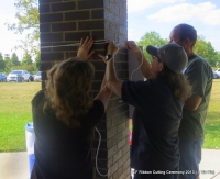 TeamWork: Putting up YFL Sign/Logo! Pic #2